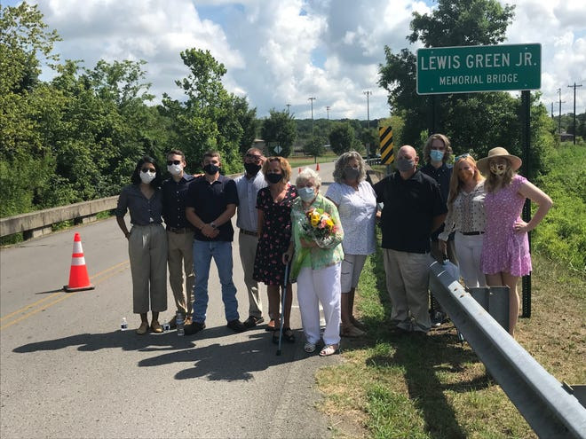 The family of the late Williamson County Commissioner Lew Green, 5th District Nolensville, including his wife, Sandy Green (front), gather at the bridge named for him on Tuesday, during an unveiling ceremony.