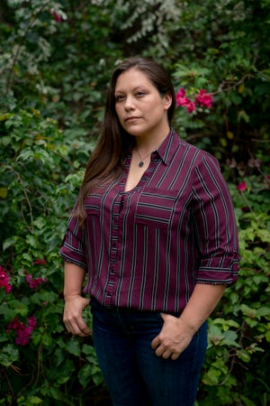 "Jessica Torres, 37, poses for a portrait at her fiancé's family home in Golden Gate Estates on Tuesday, July 28, 2020. Torres was in an abusive relationship with her high school sweetheart off and on for 17 years, and one of the ways she coped with her situation was through her art. Torres, a self-described ""big comic book nerd,"" would find inspiration in the strong female characters she loved. ""I wanted to be a strong woman, just like my mom,"" she said."