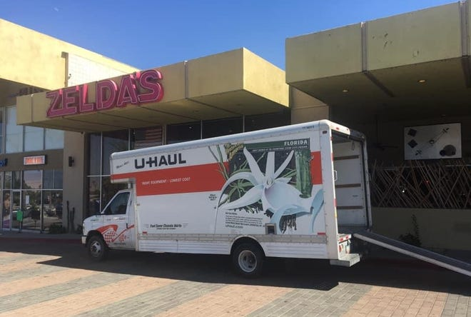 A moving van helps transport items from the Desert Rose Playhouse to its new location on July 27, 2020.