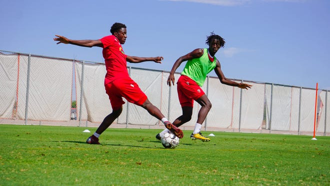Ansu Kanneh (left) and Denis Conteh are youth soccer players in the Phoenix Rising FC academy.