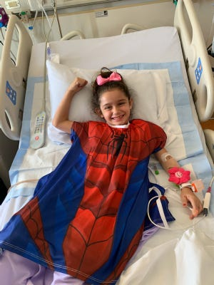 Instead of a regular hospital gown, Anaiah Morales, who's 7, got to choose from ones that look like superhero costumes. She picked Spider-Man.
