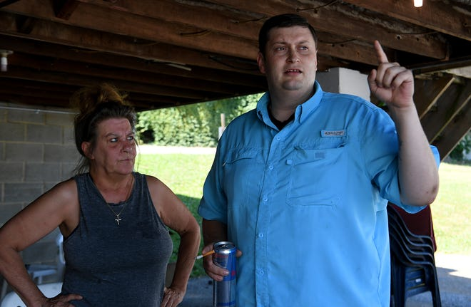 Tenant Sandy Wennersten, left, and Kyle Hopkins, chaplin of VFW 7012 in New Freedom, talk about the eviction notices tenants received giving them 90 days to move out. Wednesday, July 28, 2020. John A. Pavoncello photo