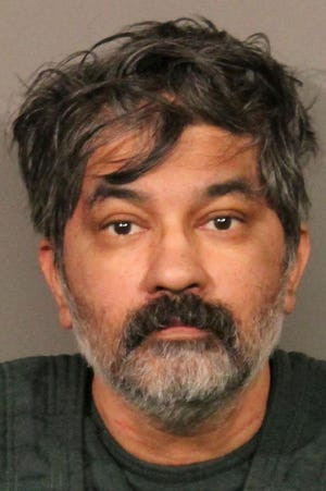 This photo released Tuesday, Oct. 15, 2019, by the Roseville Police Department shows Shankar Hangud, who police in Northern California have identified as the suspect who showed up at the Mount Shasta police station with a dead body in his car and confessed to killing that person and another three members of his family. Roseville police Capt. Josh Simon said in October that the 53-year-old Hangud was arrested after he turned himself in to Mount Shasta police and told investigators he had killed the man in his car.