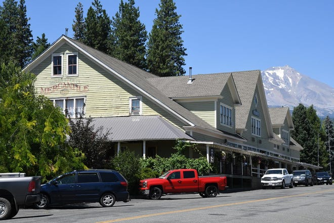 The McCloud Mercantile Hotel is seen with Mt. Shasta in the background on Wednesday, July 29, 2020.