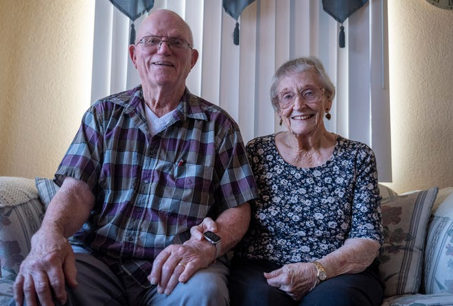 Bert and Jaqueline Loop, share a big smile as they sit on their sofa inside their trailer home in north Salinas, Calif., on Tuesday, July 28, 2020.