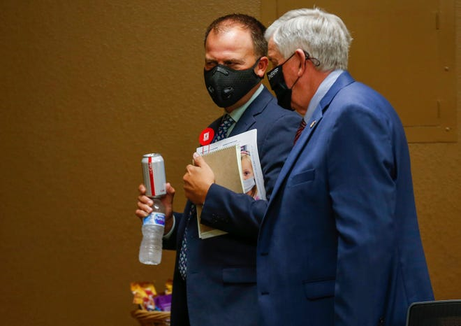 Missouri Gov. Mike Parson, right, and Springfield Public Schools Superintendent John Jungmann speak following a meeting at the Kraft Administration Center on Wednesday, July 29, 2020.