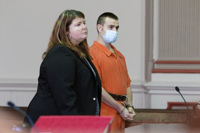 Dustin Dillon pleaded guilty to assault on a peace officer in Muskingum County Common Pleas Court. The charge stems from an incident in Dresden in May. He is pictured with his attorney, Kendra Kinney.