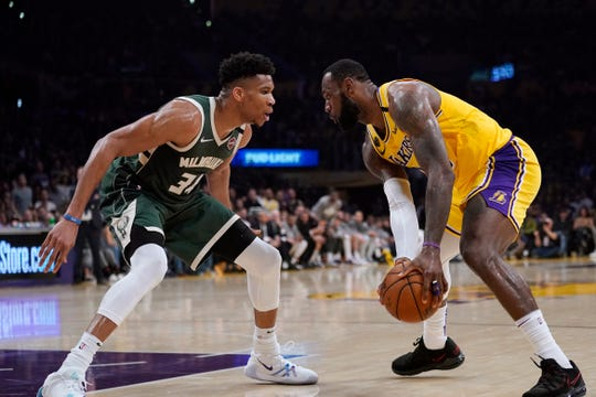 Los Angeles Lakers forward LeBron James, tries to get past Milwaukee Bucks forward Giannis Antetokounmpo during the second half of an NBA basketball game.