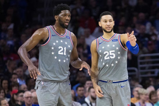 Philadelphia 76ers guard Ben Simmons (25) and center Joel Embiid (21) during the game in the second quarter against the Milwaukee Bucks at Wells Fargo Center.