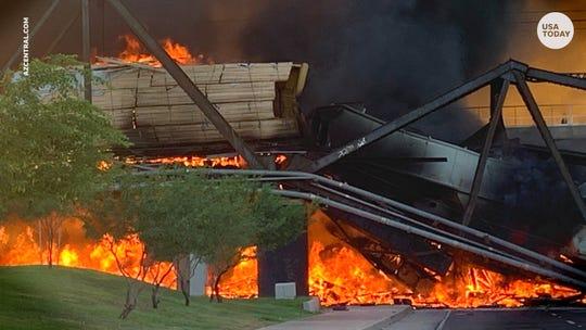 Freight train derails on bridge, erupts into flames, structure collapses