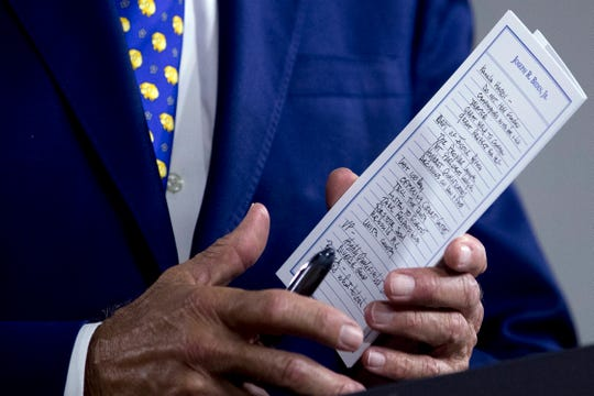 The notes of Democratic presidential candidate former Vice President Joe Biden reference Sen. Kamala Harris, D-Calif., among other things as he speaks at a campaign event in Wilmington, Delaware, on Tuesday, July 28, 2020. (AP Photo/Andrew Harnik)