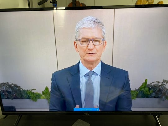 Apple CEO Tim Cook testifying to Congress