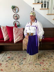 Jessie Little Doe Baird poses in her Wampanoag regalia in her home in Mashpee, Massachusetts, on July 17, 2020. Baird is a linguist best known for her work to revive and teach the Wampanoag language through The Wôpanâak Language Reclamation Project.