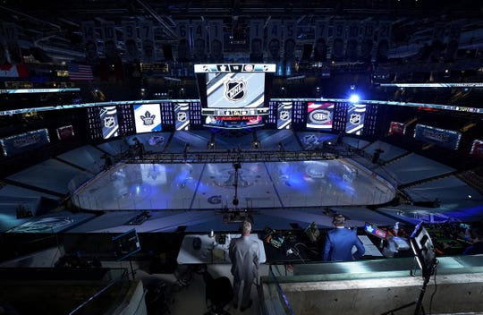 Broadcast media prepares for the start of the second period as the Toronto Maple Leafs and the Montreal Canadiens take the ice during an exhibition game prior to the 2020 NHL Stanley Cup Playoffs at Scotiabank Arena on July 28, 2020, in Toronto.