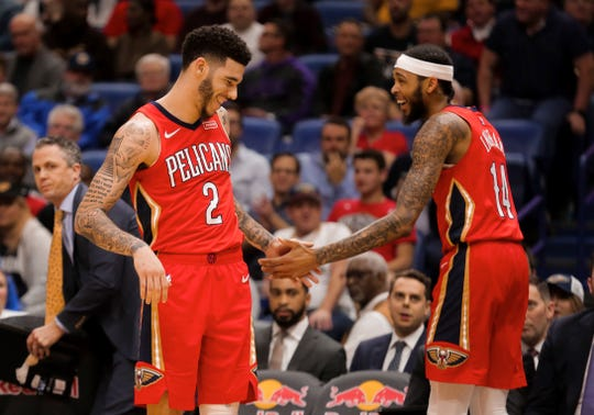 New Orleans Pelicans guard Lonzo Ball (2) and forward Brandon Ingram (14) react during the first quarter against the Utah Jazz at the Smoothie King Center.