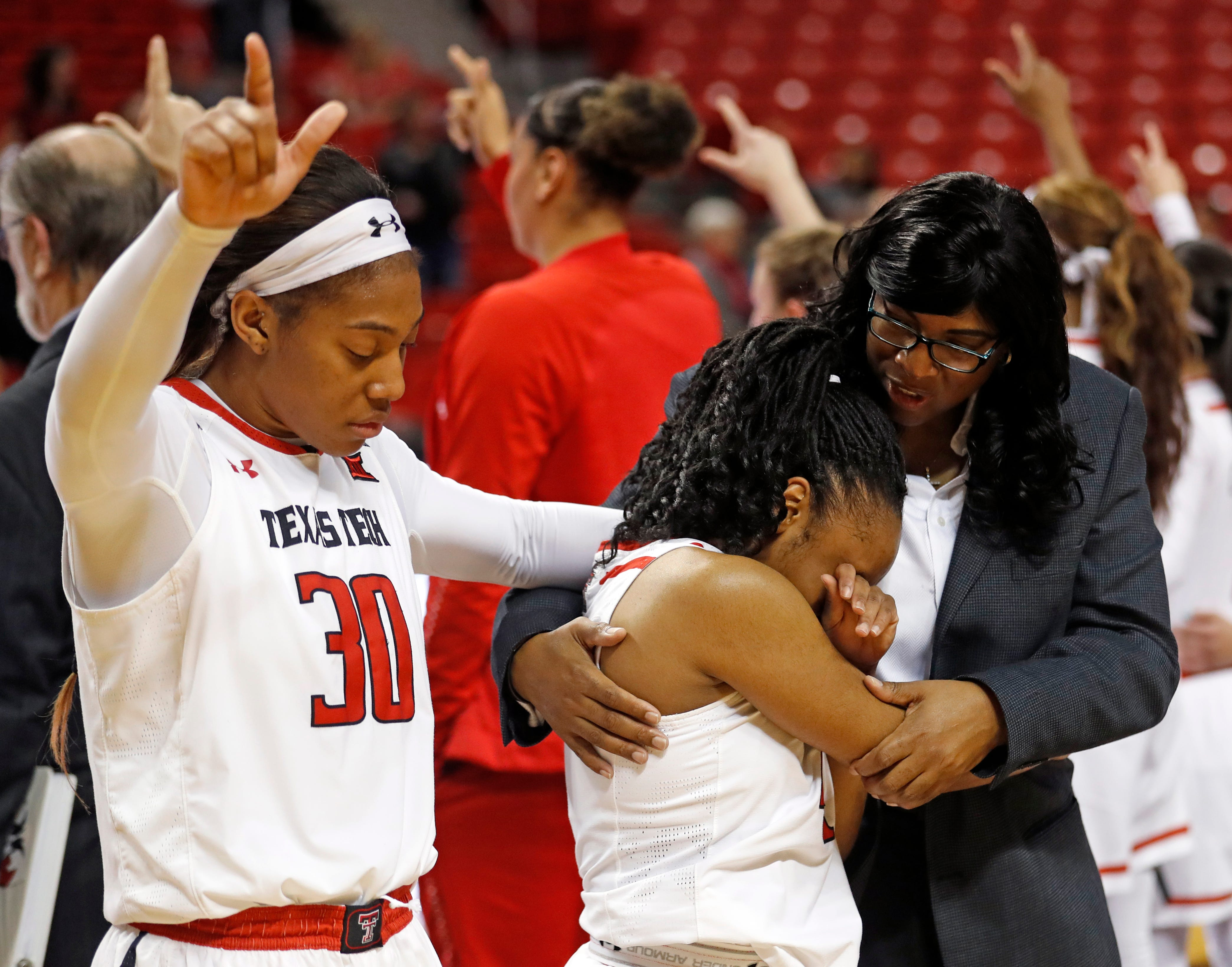 Texas Tech assistant coach Nikita Lowry Dawkins, right, holds Chrislyn Carr after she missed a potential game-winning shot after a game in February 2019.