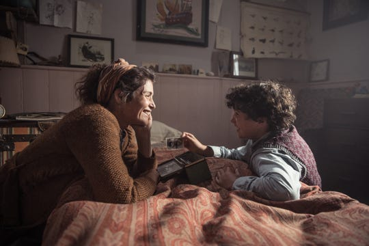 """A reclusive English writer (Gemma Arterton) takes in a young boy (Lucas Bond) evacuated from London in the World War II drama """"Summerland."""""""