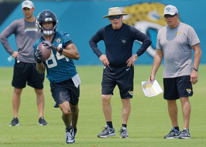 #84, Keelan Cole pulls in a pass as Executive Vice President of Football Operations, Tom Coughlin looks on from the sidelines during Tuesday's OTA session.  The Jacksonville Jaguars worked through the heat Tuesday, May 28, 2019 during their first of three OTA sessions this week at the practice fields by TIAA Bank Field. [Bob Self/Florida Times-Union]