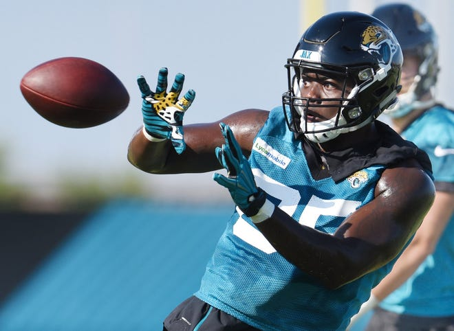 Jaguars #85, Charles Jones prepares to catch a pass during drills at Thursday morning's training camp session. The Jacksonville Jaguars training camp session on the practice fields by TIAA Bank Field Thursday morning, July 25, 2019. [Bob Self/Florida Times-Union]