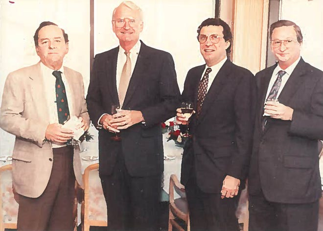 Ron Martin, far right, a former Jacksonville Journal reporter and editor, died July 22. [Provided]