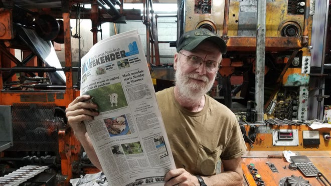 "Head Pressman Charles ""Smitty"" Smith shows the last News-Star (July 25-26, 2020 Weekender edition) be printed on the News-Star's retiring press. The News-Star now prints its papers at a sister location in Bartlesville."