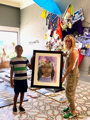 "Artist and eleven-year-old Spencer Lovett, made a three hour drive up with his mom from McKinney Texas to deliver his artwork titled ""Kept."""