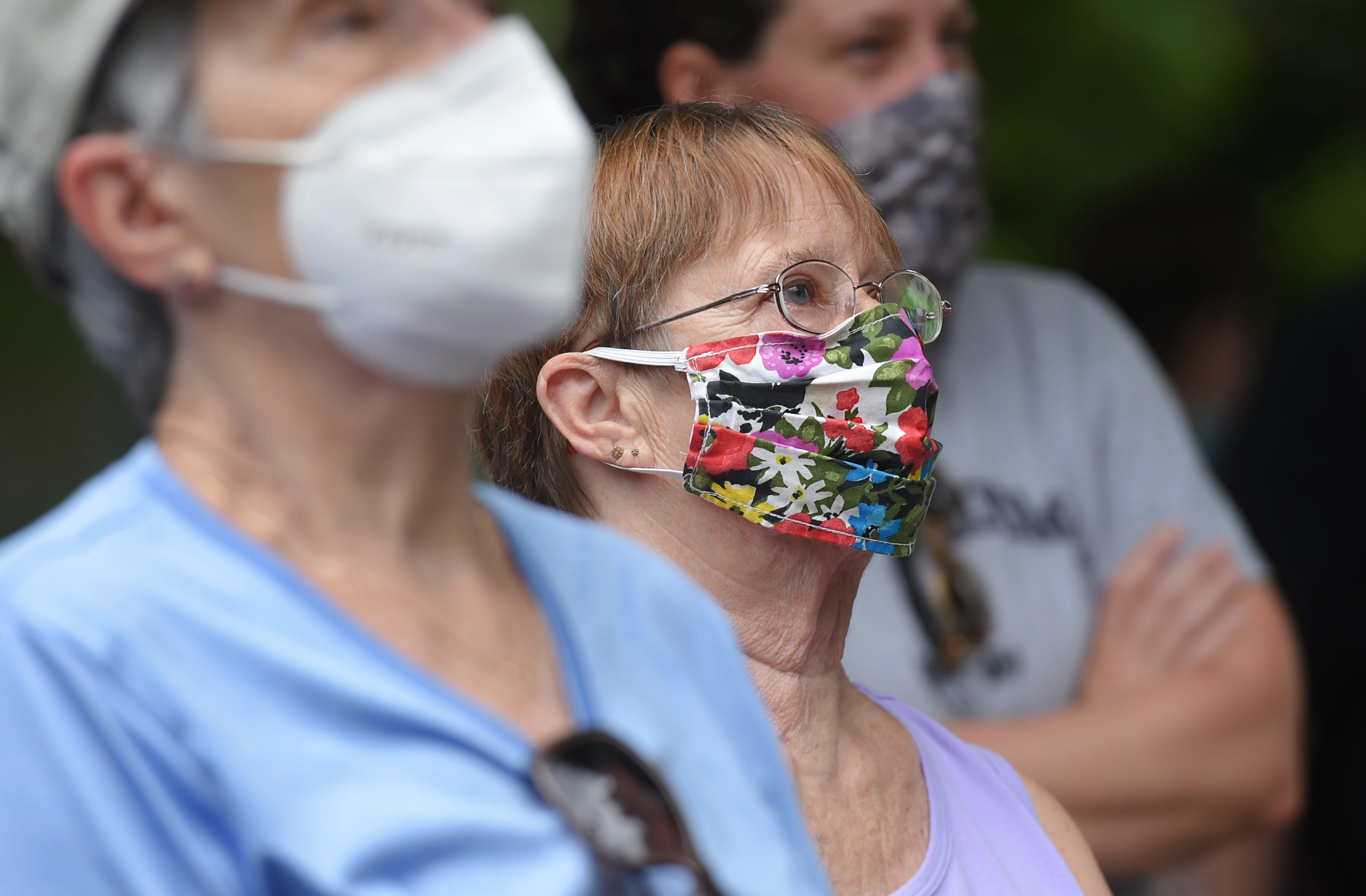 Jean Lindsey, center, the mother of Cheri Lindsey, who was murdered in 1984, watches as the Sturges St., Binghamton, house where she was murdered is demolished on Thursday, July 30, 2020.