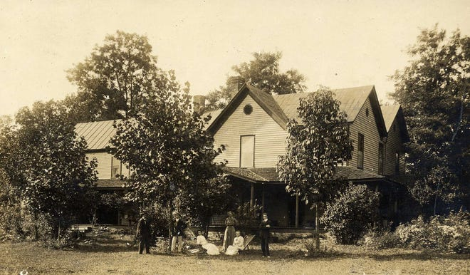 In this 1911 photograph from the Swannanoa Valley Museum and History Center's archives, a group poses in front of the Penland boarding house in Swannanoa.