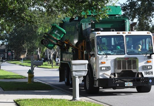 Waste Management trash pickup in the Viera area.