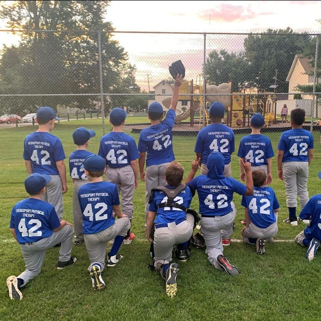 The Merchantville Little League Minors team are all wearing No. 42 to honor baseball great Jackie Robinson, who broke the color barrier in Major League Baseball in April 1947.