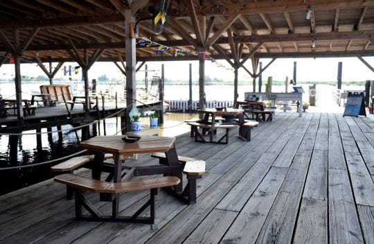 Outdoor seating along the water at the Oyster Cracker Cafe at Bayshore Center in Port Norris on Thursday, July 30, 2020.