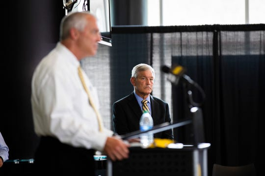 Iowa coach Kirk Ferentz (right, as Gary Barta speaks) is willing to accept the responsibility of moving the football program into a better place.