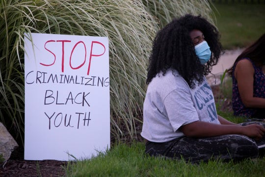 """Ashleigh Givens, 19, of Bloomfield Hills joins an overnight protest to free """"Grace,"""" a Black teen who has been held in juvenile detention since May."""