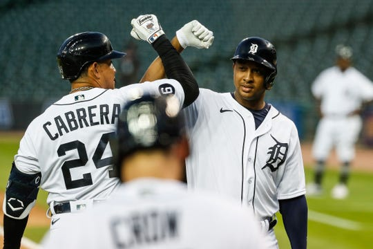 Tigers second baseman Jonathan Schoop, right, celebrates with designated hitter Miguel Cabrera after scoring a two-run home run against the Royals during the fifth inning at Comerica Park on Wednesday, July 29, 2020.