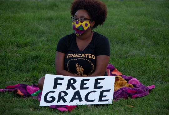 """Naomi Mae, 28, of Ypsilanti joins an overnight occupation Wednesday to free """"Grace"""" a 15-year-old Black teen who has been held in a  juvenile detention facility since May for violating her probation after not completing her online schoolwork. Mae is a University of Michigan doctoral student in education policy."""