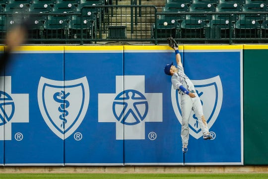 Royals right fielder Whit Merrifield fails to catch Tigers second baseman Jonathan Schoop's home run during the fifth inning at Comerica Park on Wednesday, July 29, 2020.
