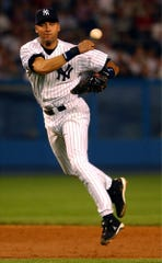 Yankees shorstop Derek Jeter throws out the Angels' David Eckstein at first during the fourth inning in Game 2 of the American League Division Series on Wednesday, Oct. 2, 2002, at Yankee Stadium in New York.