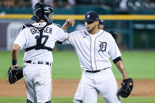 Tigers pitcher Joe Jimenez and catcher Grayson Greiner celebrate the Tigers' 5-4 win at Comerica Park on Wednesday, July 29, 2020.