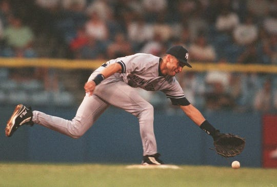 Yankees shortstop Derek Jeter can't quite reach this two-out fifth inning single by Tigers' Deivi Cruz on Wednesday, July 15, 1998, at Tiger Stadium.