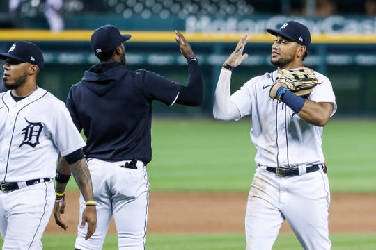 Tigers outfielder Cameron Maybin and right fielder Victor Reyes celebrate of the Tigers' 5-4 win at Comerica Park on Wednesday, July 29, 2020.
