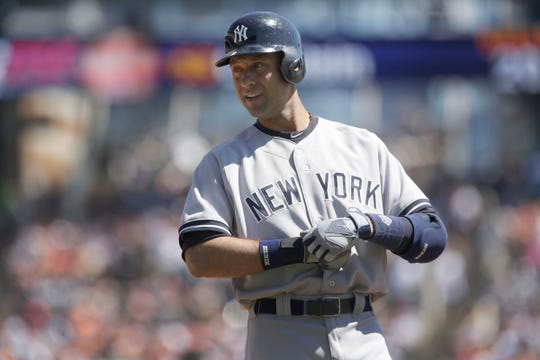 Yankees Derek Jeter smiles as he gets ready to bat during the third inning of his last regular season game in Detroit against the Tigers on Thursday, August 28, 2014, at Comerica Park.