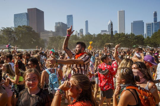 Attendees dance at the Perry's stage during the last day of the 2019 Lollapalooza Music Festival in Grant Park Aug., 4, 2019, in Chicago. A free virtual version of Lollapalooza will take place on YouTube over the same weekend, July 30-August 2.