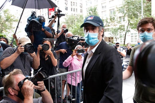Michael Cohen, President Donald Trump's former personal attorney, returns to his apartment after being released from prison, Friday, July 24, 2020, in New York. District Judge Alvin Hellerstein ordered Cohen released on parole saying he believes the government retaliated against him for writing a book about Trump.