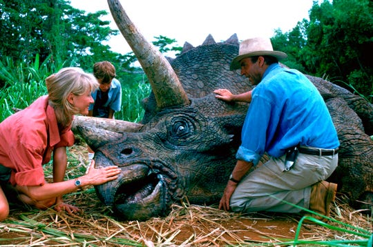 """Laura Dern, Joseph Mazzello and Sam Neill in a scene from the 1993 film """"Jurassic Park."""" With all major new releases postponed until at least Labor Day weekend due to the pandemic, summer moviegoing has belonged to the classics"""