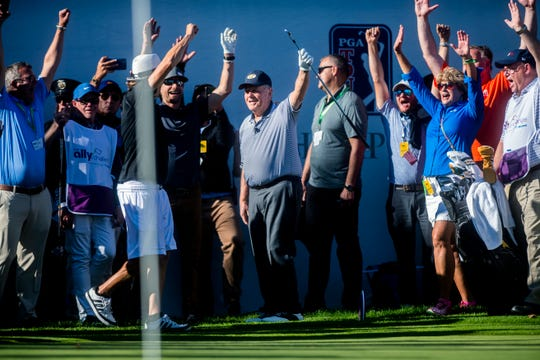 Jack Nicklaus chips in from off the green and celebrates with Kid Rock (white shorts) during last year's celebrity shootout at the Ally Challenge at Warwick Hills in Grand Blanc.