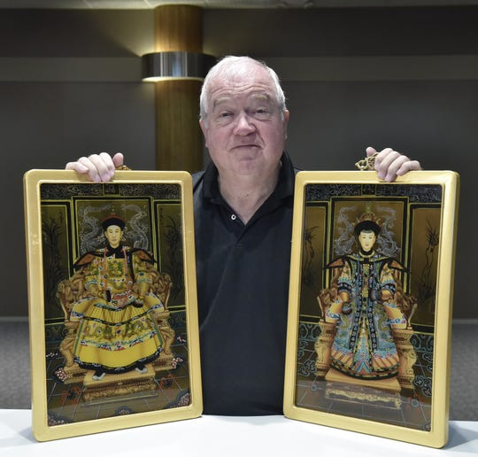 Ed McHale with two Asian panels