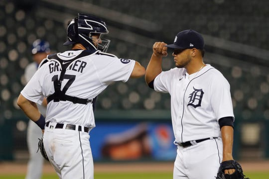 Detroit Tigers relief pitcher Joe Jimenez and catcher Grayson Greiner greet each other after the Tigers' 5-4 win over the Kansas City Royals in a baseball game, Wednesday, July 29, 2020, in Detroit.
