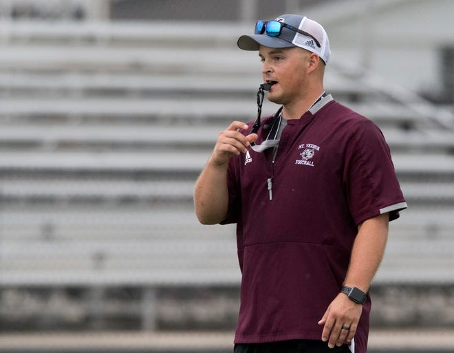 Mt. Vernon's head coach Luke Messmer blows the whistle during practice in Mt. Vernon, Ind., Wednesday evening, July 29, 2020.