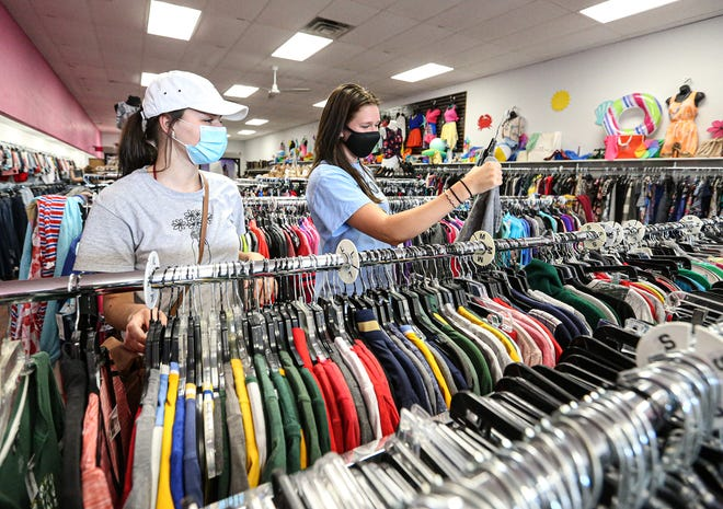 Josie Williamson and Claire Bresser of Waupun shop for clothes Thursday  at Autumn's Closet in Fond du Lac. A state-wide order to wear masks indoors, except for in private homes, goes in effect Saturday.