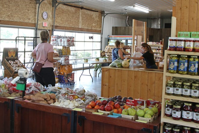 Patrons don masks as they visit, T-Jay's Farm Market's, 1160 County Road 201 in Fremont.